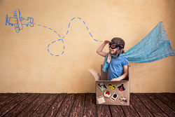 stock-photo-happy-child-playing-in-cardboard-box-kid-having-fun-at-home-303306602